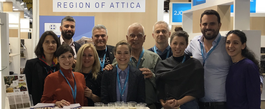 A group of people posing in the Greek Region of Attica booth at SIAL Paris