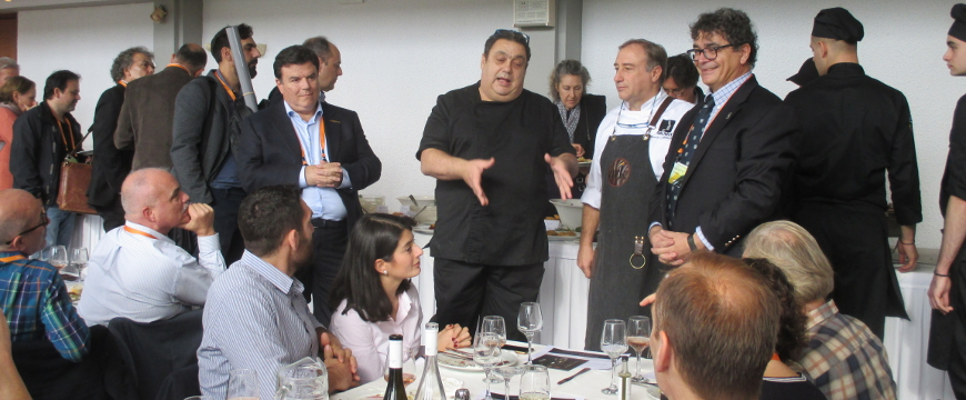 Chefs talking with people in a restaurant in Delphi