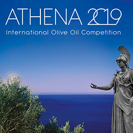 A photo of a statue of a goddess looking at an olive tree, with the blue sea and sky in the background and the words