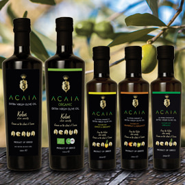 2 large and 3 small dark bottles of different kinds of Acaia extra virgin olive oil and flavored olive oil