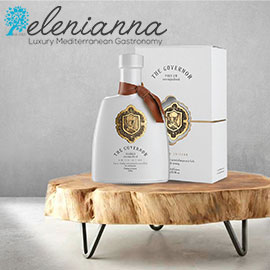 the Elenianna logo above a photo of The Governor olive oil bottle and box on a small wooden table