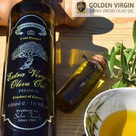a dark bottle of Golden Virgin extra virgin olive oil on the left, with a small bottle and bowl of olive oil and olive branch on the right