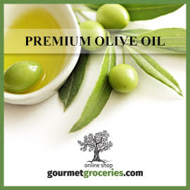 olives, olive leaves, a small bowl of olive oil, and the words