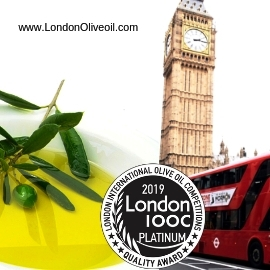 Olive oil in a bowl with olives, part of a red double decker bus, the Tower of London, a London International Olive Oil Competition award badge