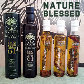 Nature Blessed black olive oil tin, dark olive oil bottle, and three clear bottles with Mediterranean herbs in virgin olive oil
