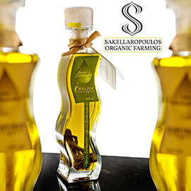 Three curvy, clear glass bottles of golden olive oil, and the Sakellaropoulos Organic Farming logo
