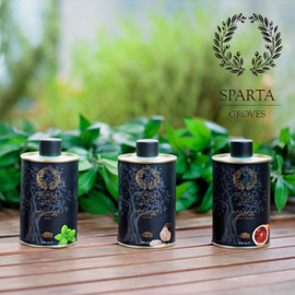 Three small tins of Sparta Groves flavored olive oils in a natural setting outdoors
