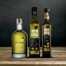 Terra Creta olive oil company's banner ad, showing three bottles of its extra virgin olive oil