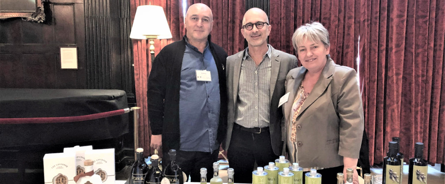 Evi Prodromou with her husband Yannis (left) and Joseph Profaci at the Greek team's table
