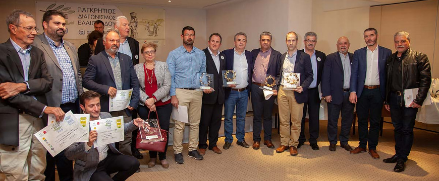 Cretan Olive Oil Competition winners lined up together with their awards