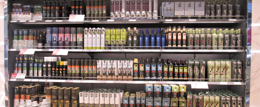 Greek extra virgin olive oils on shelves in the Athens airport
