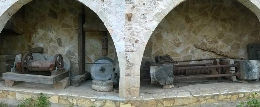 Old machinery in two arched alcoves at Anoskeli