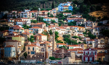 colorful houses on a hillside in the village of Plomari, Lesvos
