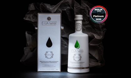 a white bottle and box of Super Premium Elawon with an image of its Platinum award from the Berlin competition