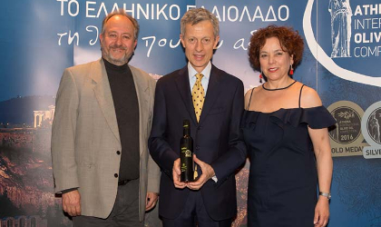 Maria Katsouli with Dino.Stergides (left) and an award winner at the Athena olive oil competition awards ceremony