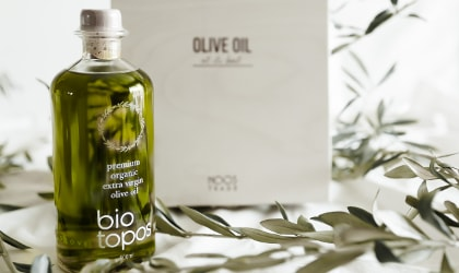 Noos Biotopos olive oil bottle with olive branches and white box