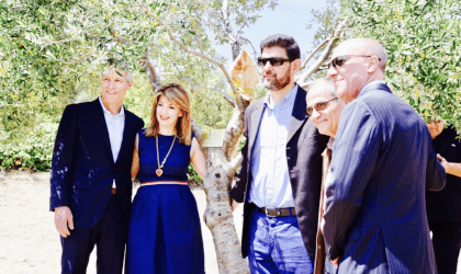 Dan Flynn, Eleni Melliou, and others at olive tree adoption by the Acropolis