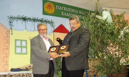 Agricultural Cooperative of Kritsa chairperson accepting an award