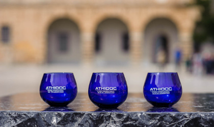 ATHIOOC blue tasting glasses in front of arches