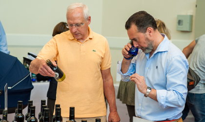 Dominique Perrot and Gabriel Malet considering different olive oils at the tasting day