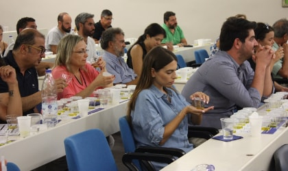 Audience members tasting olive oil at a seminar in Chania, Crete