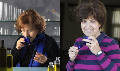 Efi Christopoulou and Maria Lazaraki holding blue olive oil tasting glasses