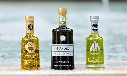 3 different Elawon olive oil bottles in a row