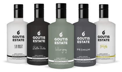 Five bottles of different Goutis Estate olive oils in a row