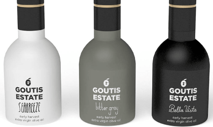 Three different bottles of Goutis Estate olive oil