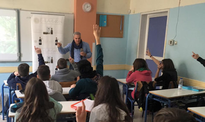Ioannis Kampouris teaching students in a Greek classroom
