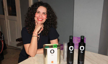 Irini Kokolaki with a tin and two bottles of O Olive olive oil
