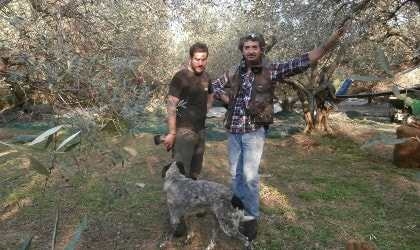 Kyriakos Makratzis, his son, and their dog in their olive grove in Crete
