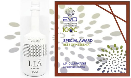 A white LIA olive oil bottle next to its Best in Messenia award certificate