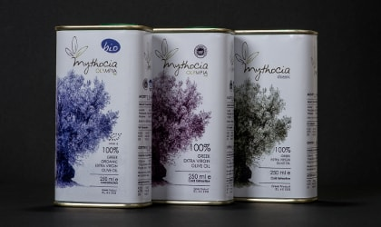 three tins of Mythocia olive oil with olive tree drawings on them