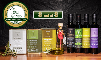 "Sakellaropoulos Organic Farming's 8 award-winning products lined up in a row, with the Olivinus logo and ""8 out of 8"" above them"