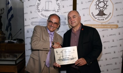 Yannis Prodromou accepting an award on behalf of Yanni's Olive Grove