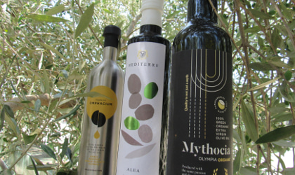 bottles of Papadopoulos olive oil in an olive tree