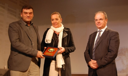 Grecotel representatives accepting an award from the Mayor of Rethymno
