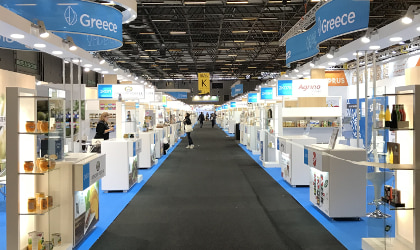 A view of the Greece section of SIAL Paris, looking down the aisle, with booths on either side