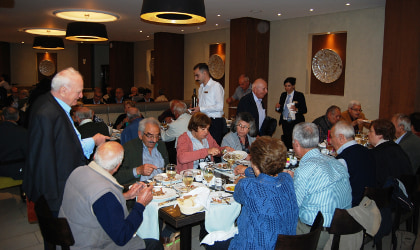 people eating and talking at the World Olive Day event in Grecotel's restaurant