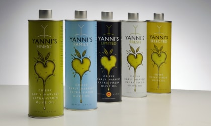 Yanni's different colored olive oil tins in a row