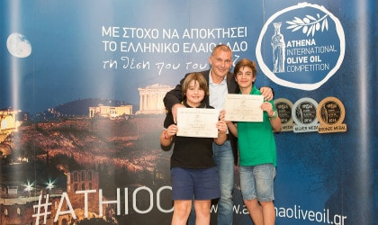 Giovanni Bianchi and his sons with their award for Argali olive oil at the Athena International Olive Oil Competition