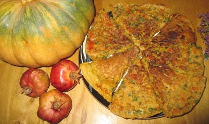 carrot onion parsley frittata pictured with pumpkin and pomegranates