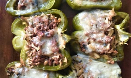 a photo of lamb stuffed green peppers