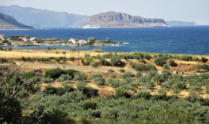 olive trees, blue sea, Monemvasia in the background