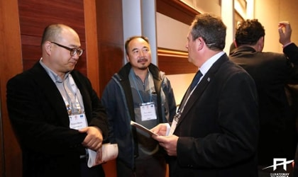 Emmanouil Karpadakis meeting with two Korean businesspeople