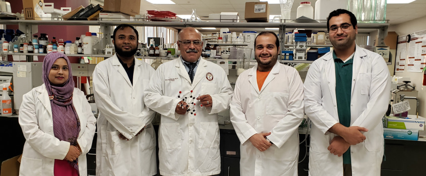 Dr. Khalid El Sayed (center) with his research group in his lab