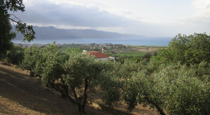 German World War Two cemetery at Maleme, with olive trees, sea, mountain view