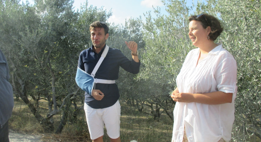 Eftychis and Chloe starting their seminar by the olive trees