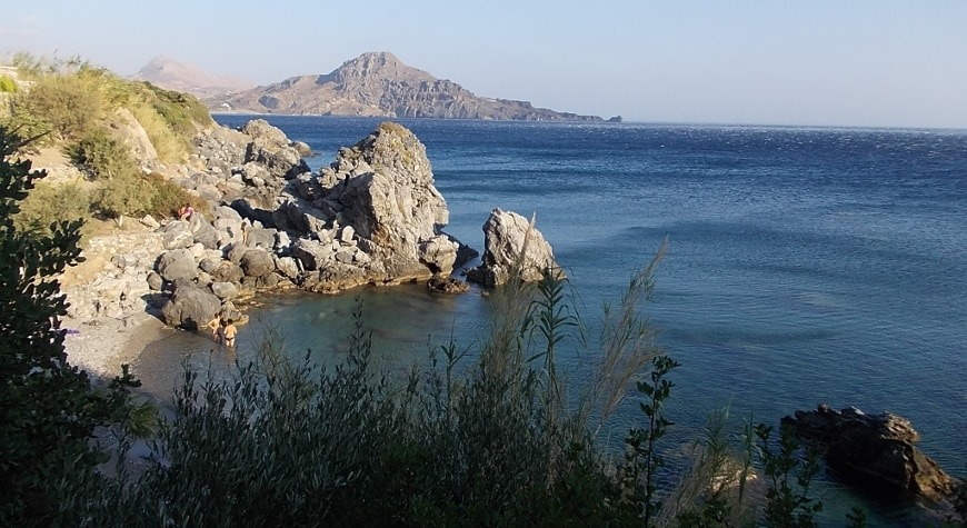 small cove, sea, boulders, hills, and sky between Plakias and Souda Beach